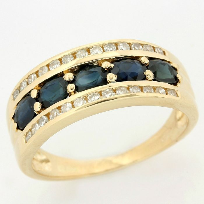 14kt Yellow Gold 1.00ct Oval Cut Sapphire and 0.25ct Round Brilliant Cut Diamond Ring; Size: 7