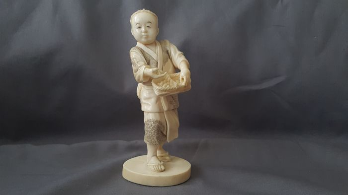 """Fine quality  ivory okimono """" Boy with basket  """" - Japan - ca. 1900 , signed in red seal"""