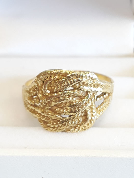 18 kt yellow gold carpet beater ring unisex