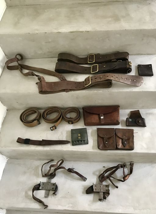 Lot of 14 military items in leather. Cartridge belt, belt, holster, case...