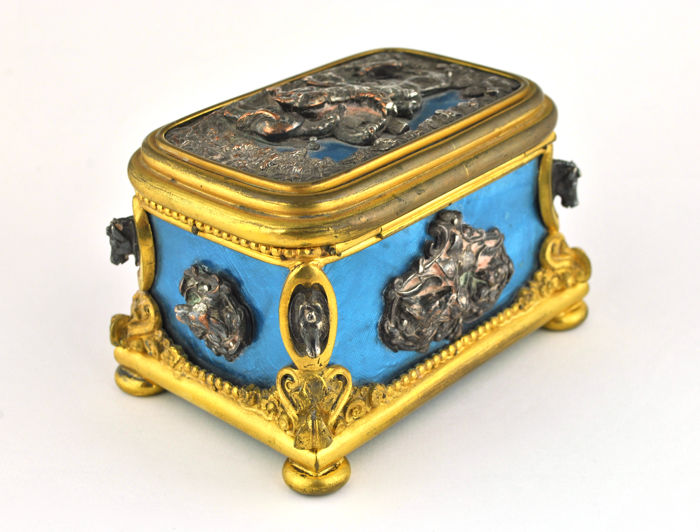 "Tahan à Paris - a guilloché enamel ""Retour de Chasse"" box - gilt and silvered metal; bronze and/or copper"