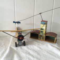 2 Tin items 1 airplane Bristol bulldog Airplane made in Japan 1 station with 2 aircraft made in Germany