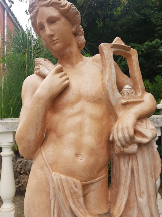 Figure in terracotta of God Apollo Zither
