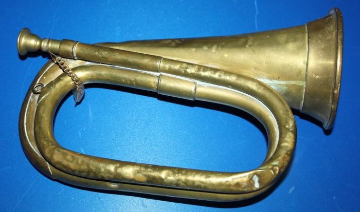 A military  bugle, marked: Mayers & Harrison  Makers, Manchester  and a broad arrow  , brass,  in  good condition