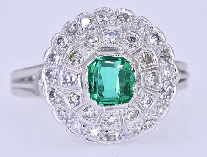 1.01 Ct Emerald with Diamonds ring. 18kt gold, size 14 adjustable. No reserve price.