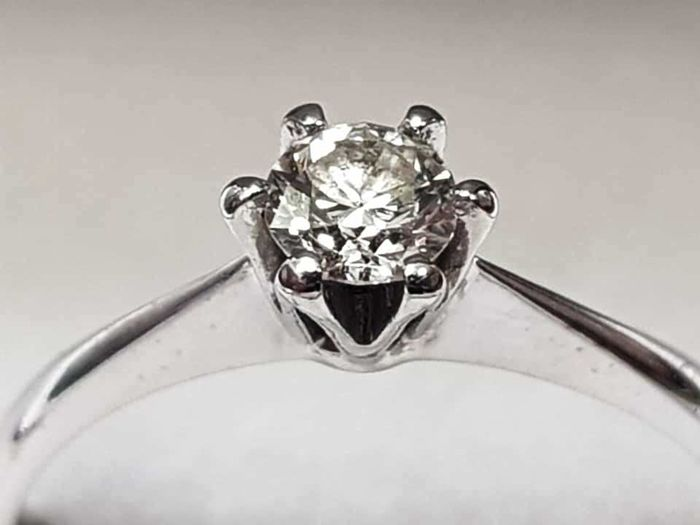 18 kt gold solitaire set with a diamond of 0.25 ct - size 53 - No reserve price