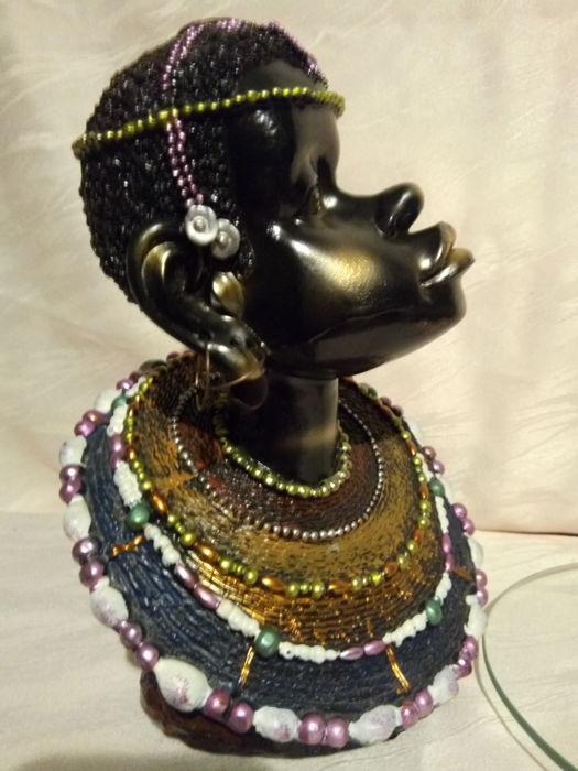 Old sculpture in compressed fibre resin decorated with beads and shell, glass plate screwed on the head, h 27 cm