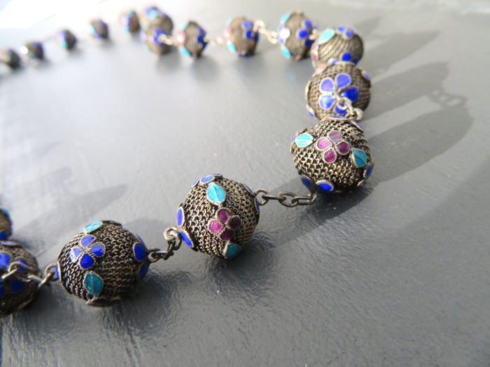 Necklace made of 835 silver, cutaway spheres decorated with colourful enamel ornaments.