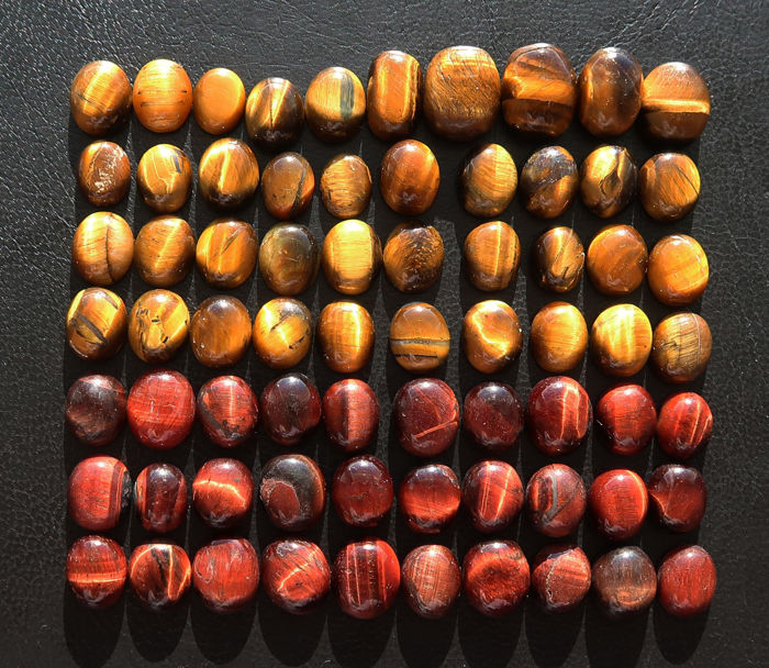 Tiger's eye cabochons - 70 stones - 300.5 ct