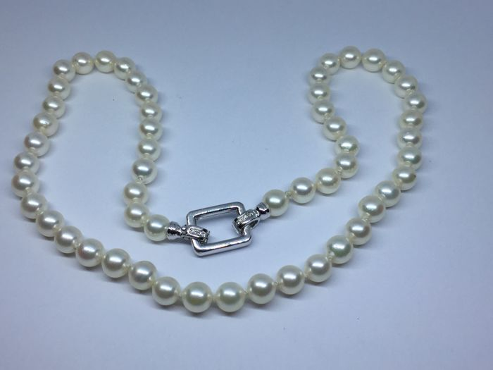 Japanese pearl necklace  7.00/7.50 mm with 19 kt white gold clasp.  with diamonds