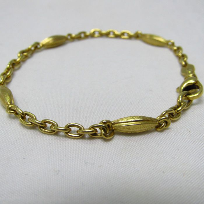 Bracelet in viewed and matte gold of 18 kt with intertwined links 9.40 g