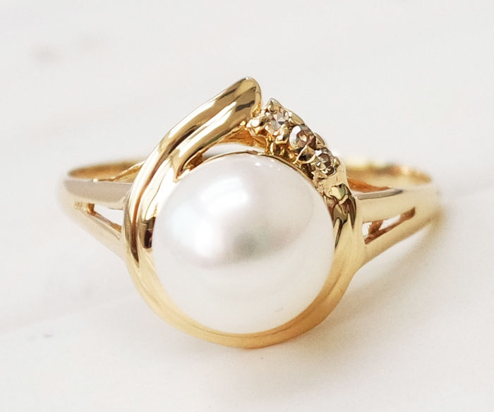 14KT Yellow Gold Ring with 7 mm Akoya Pearl ,  0.021 ct Diamond  - Size M 1/2