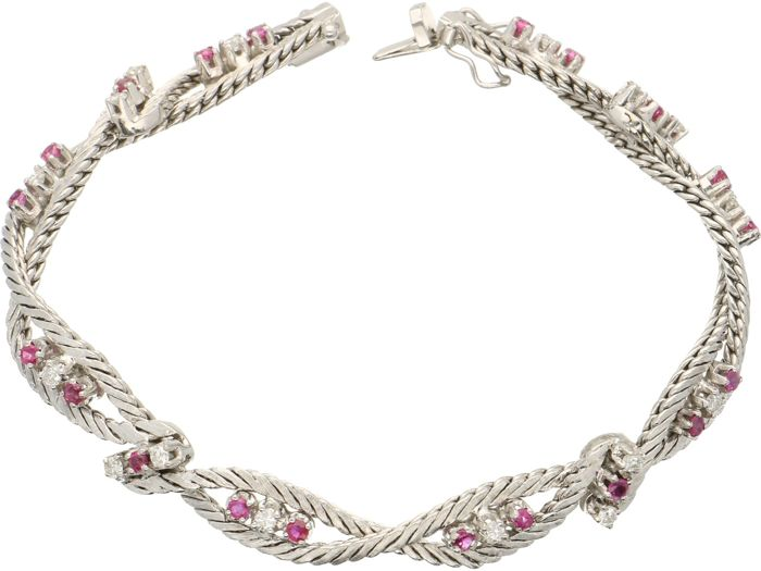 18 kt - White gold women's bracelet set with 20 x ruby and 16  brilliant cut diamonds of approx. 0.64 ct - Length 18 cm x 0.7 mm wide.