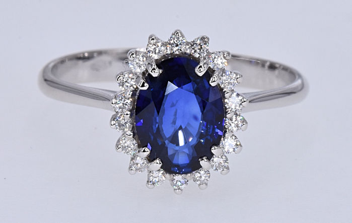 1.66 Ct Sapphire with Diamonds ring . 18kt white gold, size 13.5 adjustable. NO reserve price.