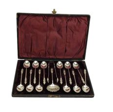 "Silvered ""apostles"" teaspoons + tongs + spoon - Silverplate"