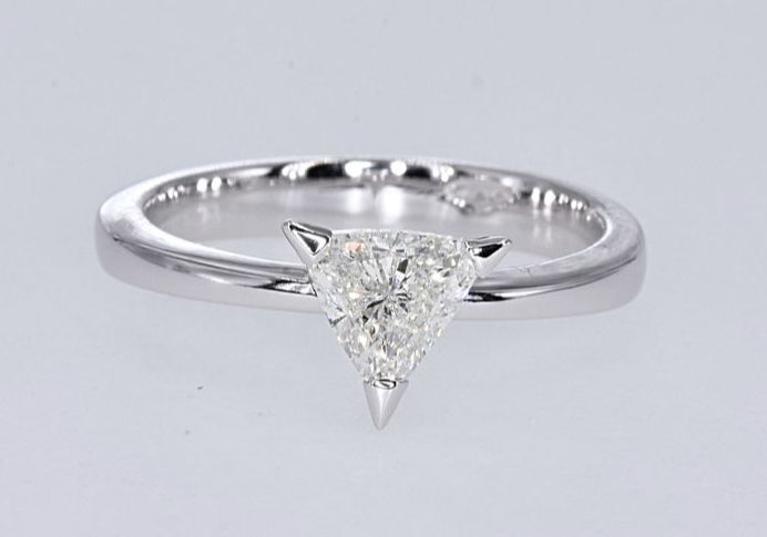 1.12 Ct Diamond solitaire trillion ring. size NO reserve price. Size 13.5 adjustable. 18kt gold.