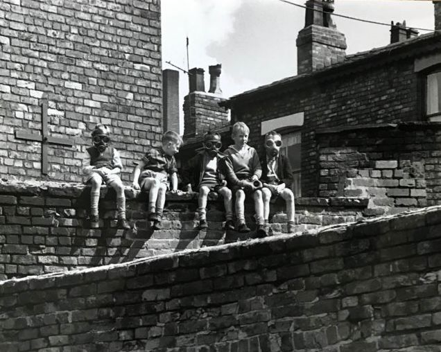 Shirley Baker (1932-2014)  - Salford 1962, children sitting on the wall