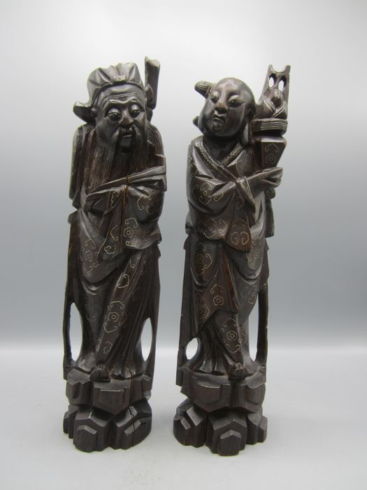 2 sculptures of Immortals with silver inlay - China Fujian - 19th century