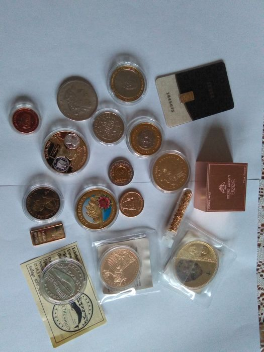 0.5 grams gold certified 999/1000 + 500 grams copper Switzerland + a lot of coin and bullion gold plated