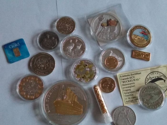 0,5 grams  gold certified 999/1000  +  gigant medal titanic 110 grams 70 mm diameter  +  a lot of coin and bullion  gold plated