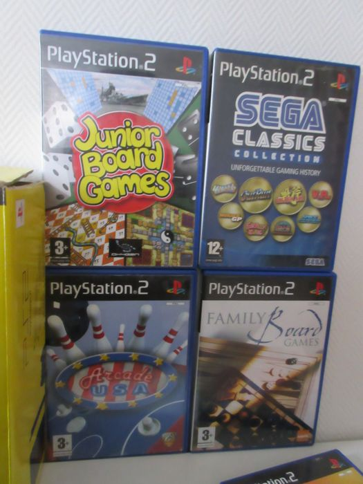 Sony Playstation 2 Slim Console with: Eye toy and 5 PS2 Games, In