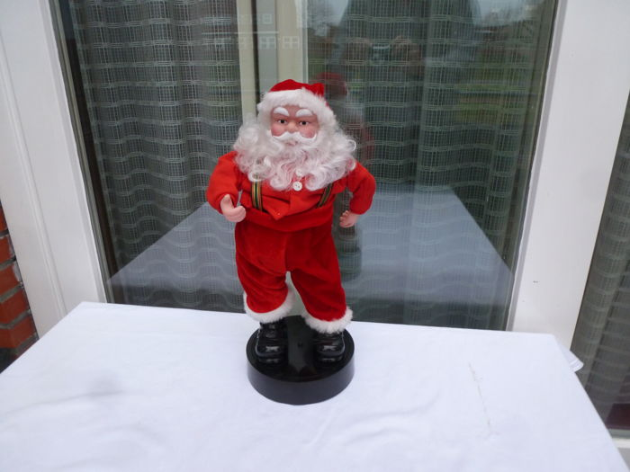 With the Hips swaying singing Santa - Resin/Polyester