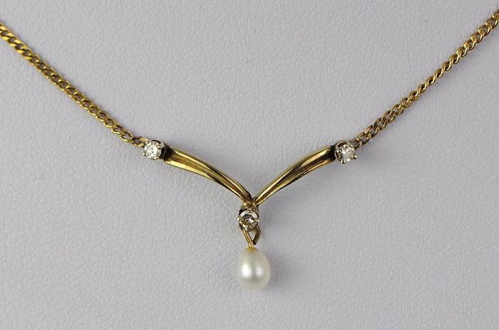 Necklace off - Gold - 0.15 ct - Diamond