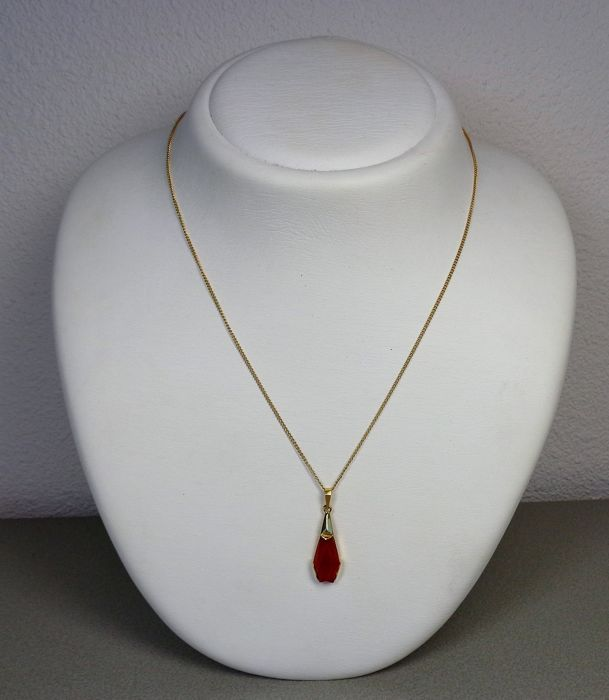 14 kt gold pendant with carnelian. On necklace.