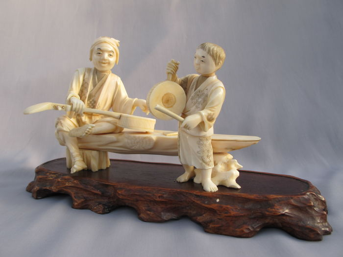"Beautiful,signed  ivory Okimono on wooden stage,, Father and Son making Music""-  Japan - ca 1900 (Late Meiji period)"