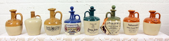 Whiskey jugs - collection of 8 enamelled stoneware