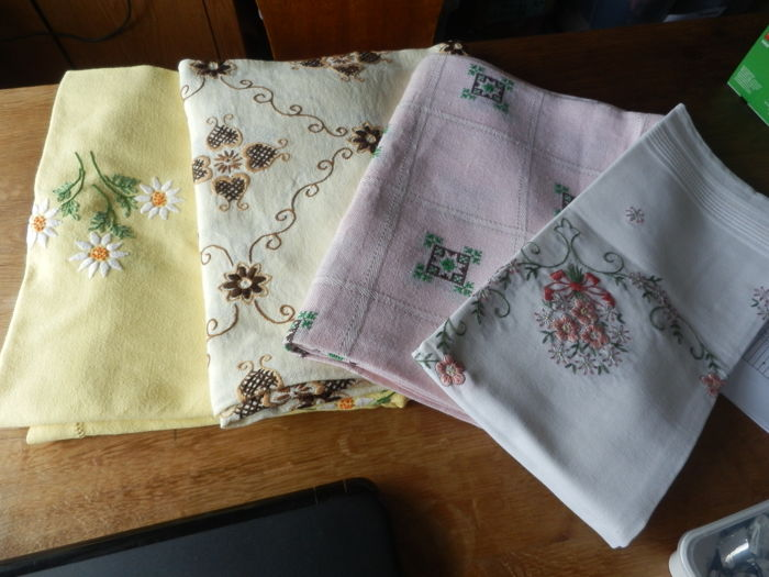 With the hand embroidered tablecloths / sheets - 4 -linen