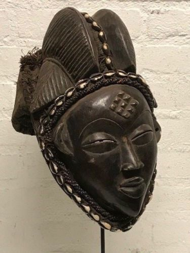 African female mask from the Punu with Cap - Gabon.