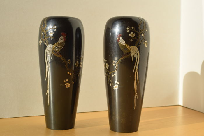 Two bronze vases inlaid with gold and silver of two roosters in a flowering prune tree - Japan - 1900-1920's (Late Meiji-Taisho Period)