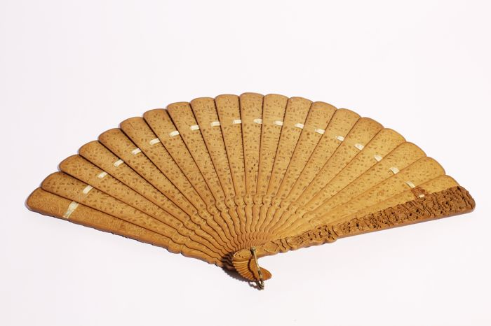 A delicately carved fan made of sandalwood - China - 19th