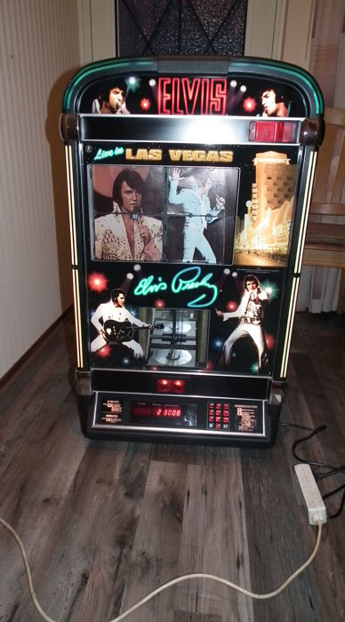 Rare Elvis Presley Jukebox for 100 CD's with led lights and remote control  - Catawiki