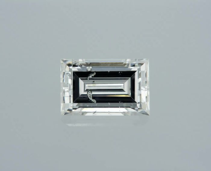 1 pcs Diamant - 0.61 ct - Baguette - E - SI2