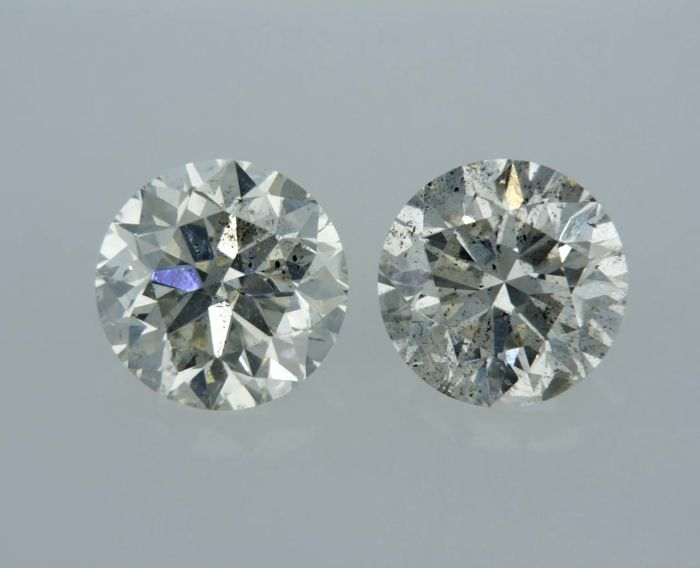 2 Diamonds - 1.43 ct - Brilliant - F - SI1