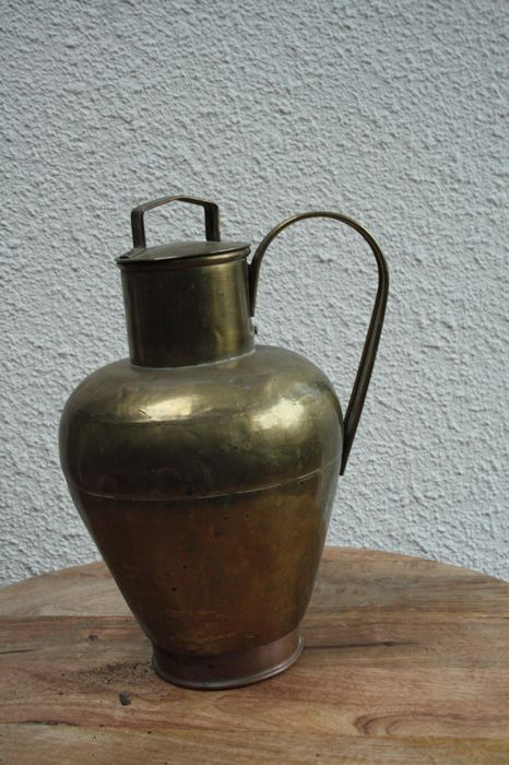 Old yellow copper pitcher