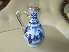 A blue and white porcelain Ewer, Chinese, mid 17th century