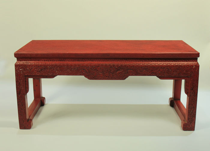 A Chinese decorative Carved dragon red lacquer table - China - 21st century