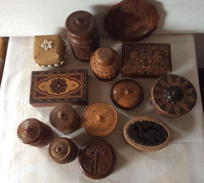 Collection of fourteen wooden and wicker pots and boxes