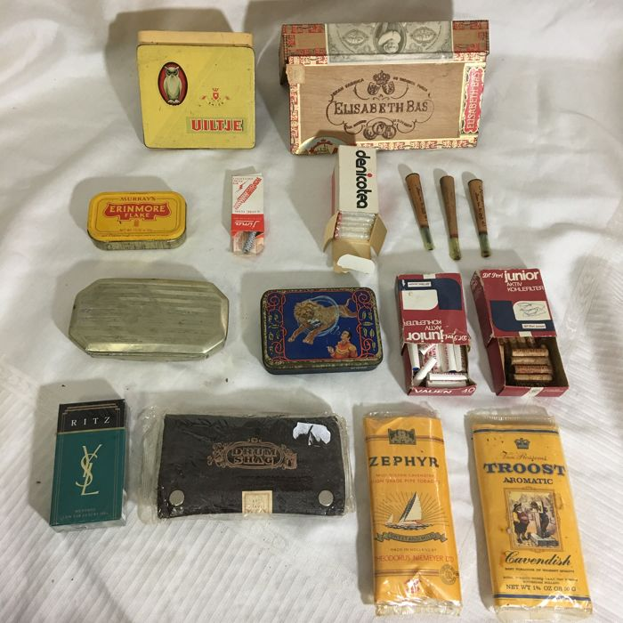 Smoking collector items: tobacco boxes and supplies, senator brand pipes, sealed tobacco and Ritz Yves Saint Laurent cigarette packs - 20th century.
