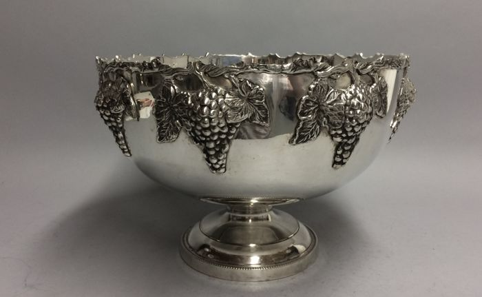 Large silver plated champagne or wine cooler in Art Deco style decorated with grapes