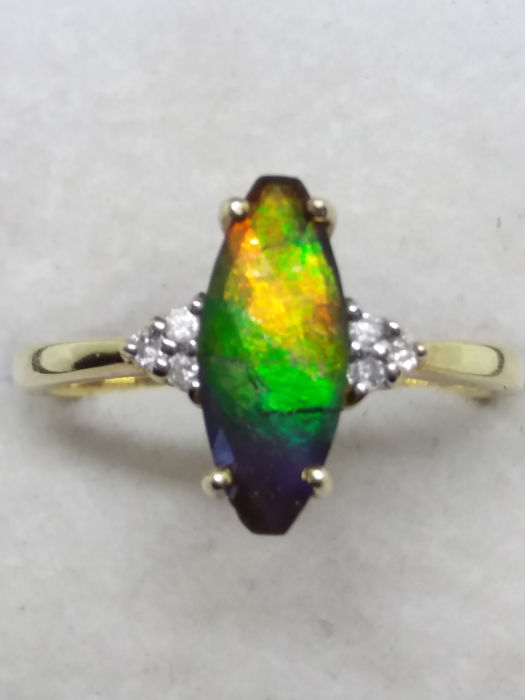 Vintage   Marquise cut  Ammolite and 6 old cut diamonds in yellow gold. .