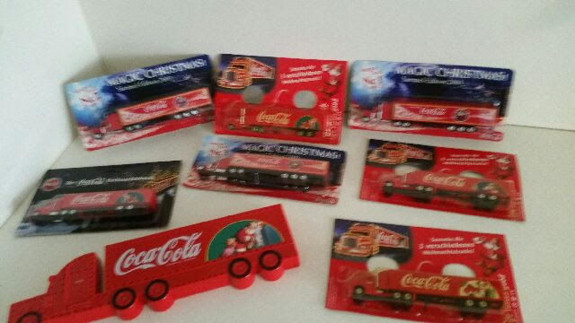 8 Coca Cola Santa Christmas Trucks in original packaging