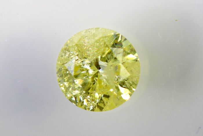 AIG Sealed Diamant - 0.60 ct - Fancy Yellow ,  I2 - Excellent Cut  - No Reserve Price