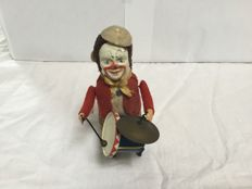 Schuco, Germany - height 11 cm - drumming clown, 1950s
