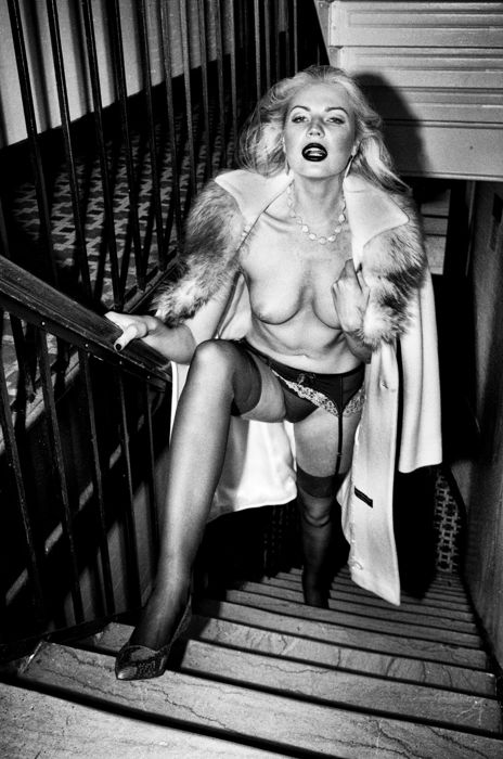 Photo; Marco Tenaglia - Woman on the stairs with open coat - 2017