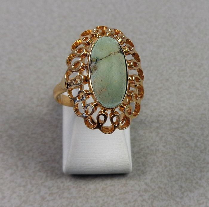 14 kt gold ring with turquoise.