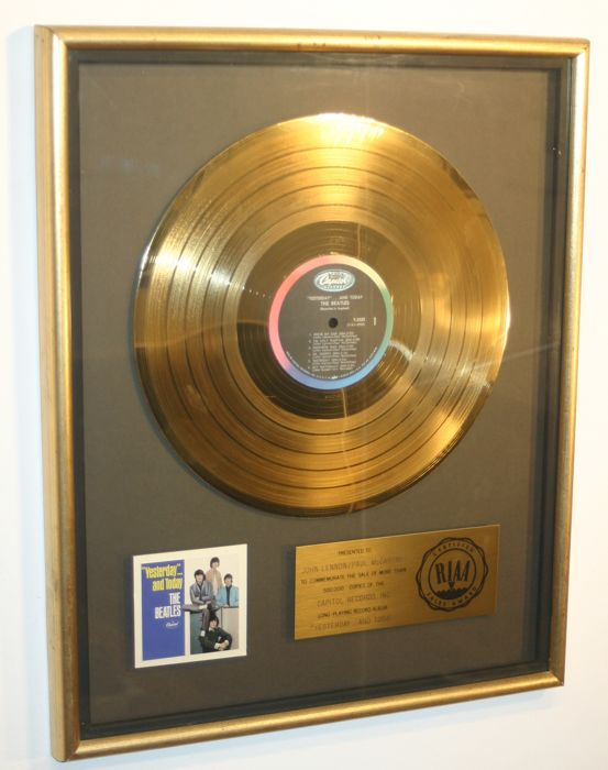 "The Beatles - Official Golden RIAA Award - For the sale of 500.000 copies of ""Yesterday ... and today"" presented to John Lennon and Paul McCartney"